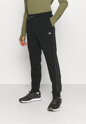 WINTER FUTURE ICONS - Tracksuit bottoms - black
