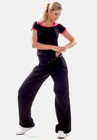 Winshape - Outdoor trousers - schwarz - 1