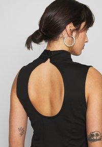 Lost Ink Petite - SLEEVELESS FISHTAIL BODYCON DRESS - Jersey dress - black - 4