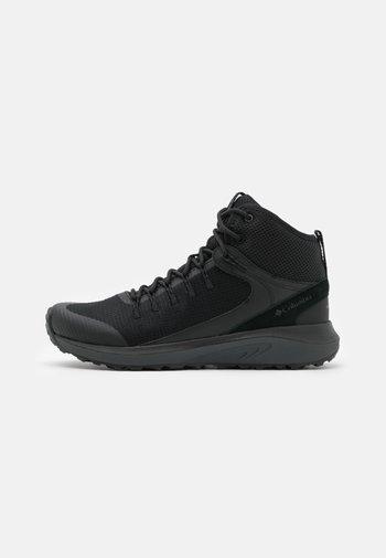 TRAILSTORM MID WATERPROOF - Hiking shoes - black/dark grey