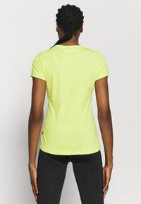 Puma - REBEL GRAPHIC TEE - T-shirt con stampa - sharp green/black - 2