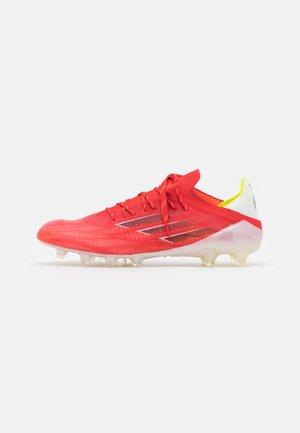X SPEEDFLOW.1 AG - Voetbalschoenen met kunststof noppen - red/core black/solar red