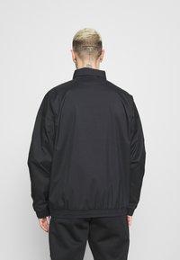 adidas Originals - UNISEX - Training jacket - black - 2