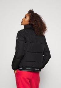 Calvin Klein - LOGO PUFFER JACKET - Winter jacket - black - 2