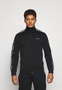 Jack & Jones Performance - JCOZTAPING TRACK SUIT - Chándal - black - 0