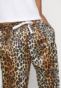 adidas Originals - LEOPARD PANT - Tracksuit bottoms - multco/mesa - 3
