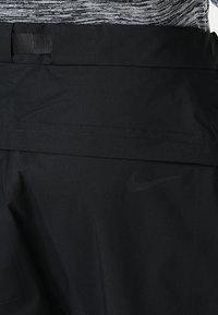 Nike Golf - HYPERSHIELD PANT CORE - Trousers - black - 7