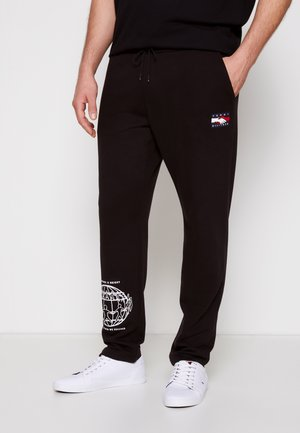 ONE PLANET UNISEX - Tracksuit bottoms - black