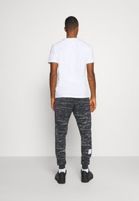 Nike Sportswear - Tracksuit bottoms - black/iron grey - 2