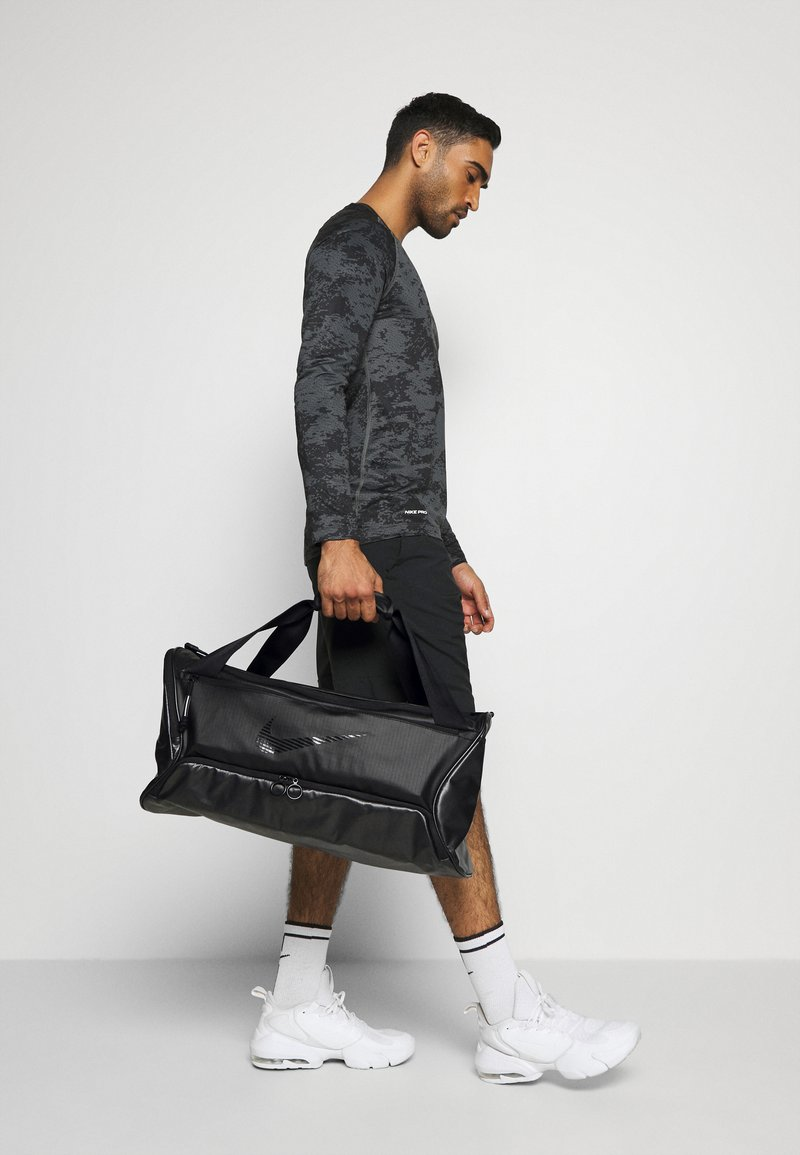 Nike Performance - DUFF UNISEX - Sports bag - black/black/black