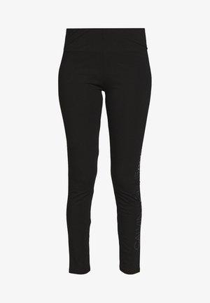 INSTITUTIONAL LOGO - Leggings - Trousers - black
