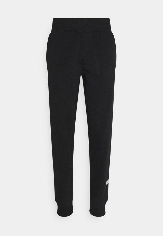 MELVIN PANTS UNISEX - Teplákové kalhoty - black