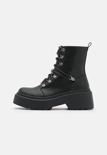 JACKSON - Lace-up ankle boots - black