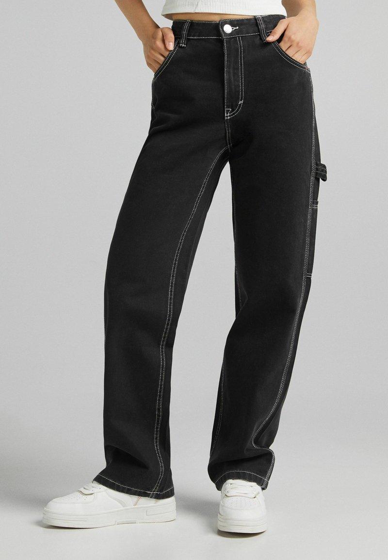 Bershka - Flared Jeans - dark grey