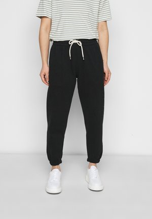 EASY - Tracksuit bottoms - true black
