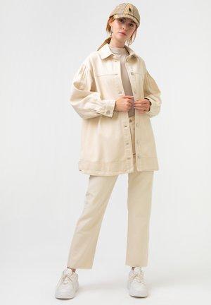 STITCH DETAILED - Denim jacket - beige