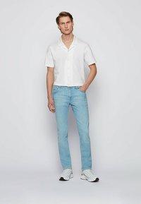 BOSS - Slim fit jeans - light blue - 1