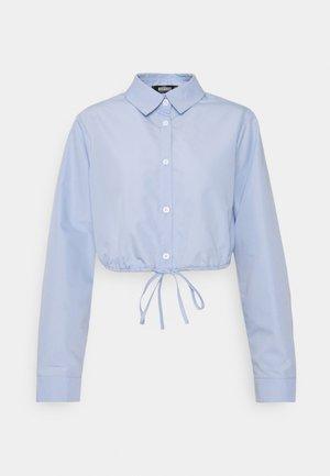 FRONT TIE CROP SHIRT - Button-down blouse - baby blue