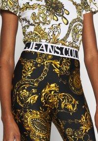 Versace Jeans Couture - PANTS - Legginsy - black/gold - 3