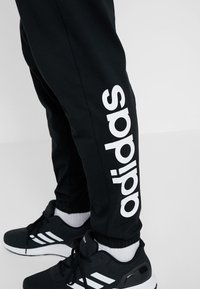 adidas Performance - Tracksuit bottoms - black/white - 3