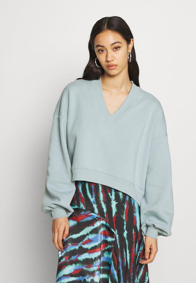 STELLA - Sweatshirt - blue/green