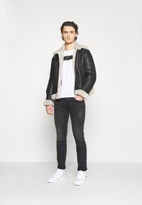 Replay - ANBASS BIO - Slim fit jeans - dark grey - 1