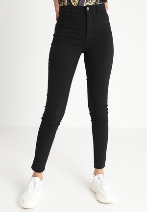 PCHIGHSKIN WEAR  - Jeansy Skinny Fit - black