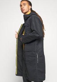 adidas Performance - ATHLETICS TECH SPORTS RELAXED JACKET - Training jacket - black - 3