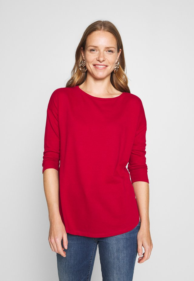 Long sleeved top - brick red