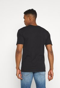 Nike Sportswear - REPEAT - T-shirt imprimé - black - 2