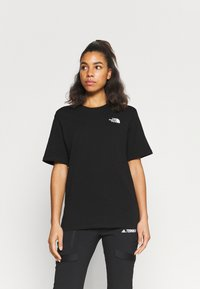 The North Face - INTERNATIONAL WOMENS DAY TEE - T-shirts med print - black - 2