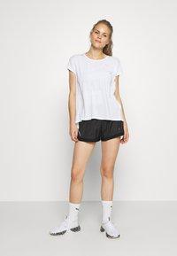 Puma - BE BOLD TEE - Print T-shirt - white - 1