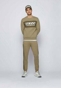 BOSS - HADIKO  - Tracksuit bottoms - dark green - 1