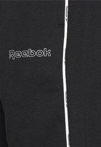 Reebok - TRAINING ESSENTIALS PIPING - Tracksuit bottoms - black - 2