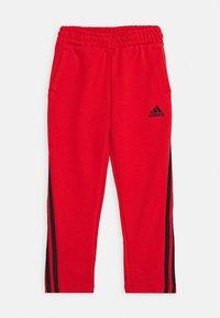 adidas Performance - STRIPES ATHLETICS SPORTS REGULAR PANTS UNISEX - Pantalones deportivos - hirere/black - 0