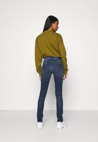 Diesel - D-ROISIN - Jeans Skinny Fit - washed black - 2