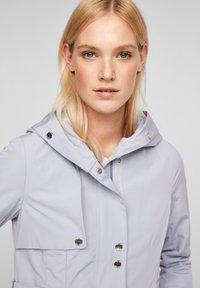 s.Oliver - MIT NETZ-FUTTER - Waterproof jacket - lilac - 4