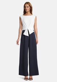 Vera Mont - MIT WEITEM BEIN - Jumpsuit - dark blue/cream - 0