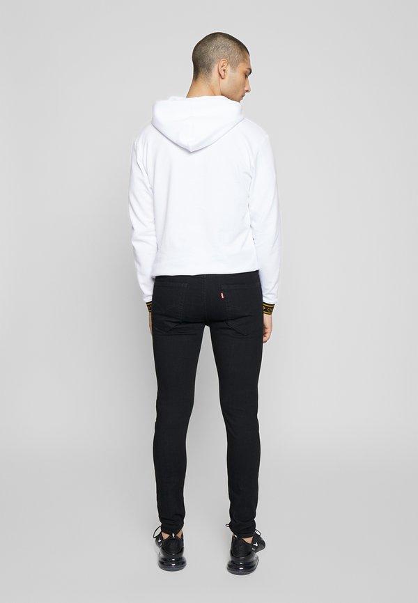 Levi's® SKINNY TAPER - Jeansy Skinny Fit - black denim/czarny denim Odzież Męska RLDT