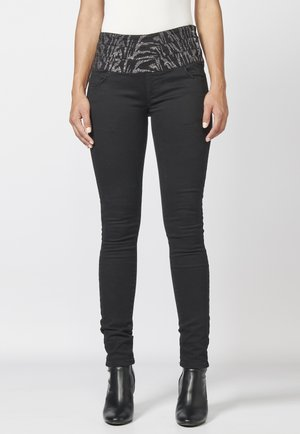 FAJÍN - Pantalones - black