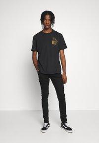 AllSaints - CIGARETTE  - Slim fit jeans - black - 1