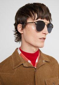 Gucci - Sunglasses - black/gold/grey - 1
