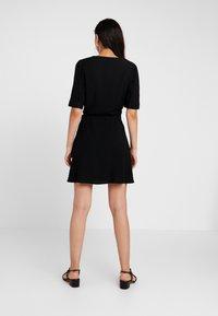 NA-KD - WRAP PUFF SLEEVE MINI DRESS - Day dress - deep black - 3