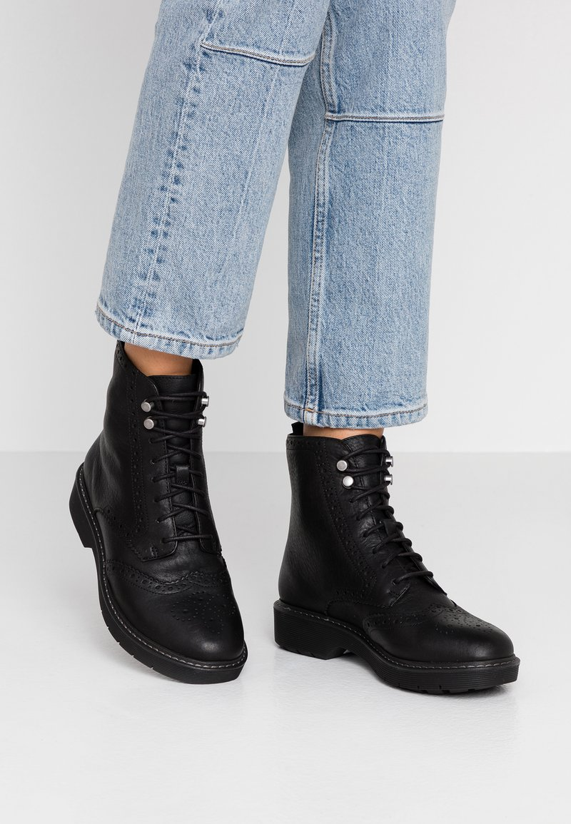 Clarks - WITCOMBE FLO - Lace-up ankle boots - black