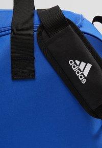 adidas Performance - Sports bag - bold blue/white - 5