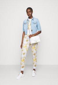 Versace Jeans Couture - Spodnie treningowe - white - 1