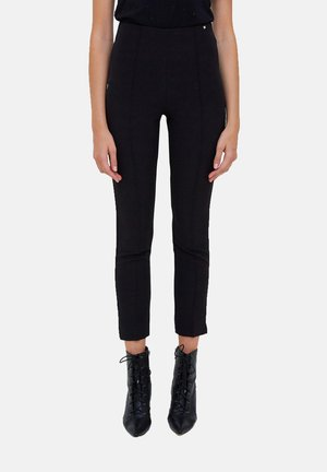 CON NERVATURE - Trousers - nero