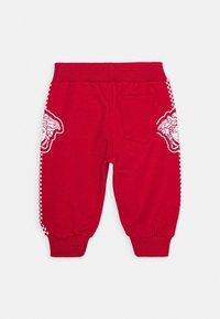 Versace - BOTTOM FELPA UNISEX - Trousers - rosso - 1