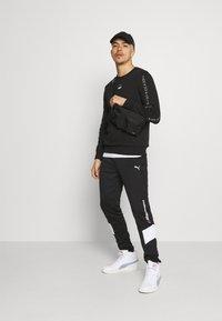 Puma - ELEVATE CREW  - Sweatshirt - black - 1