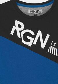Re-Gen - TEEN BOYS  - Triko spotiskem - nautical blue - 2